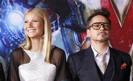 Cast members Robert Downey Jr. and Gwyneth Paltrow pose at the premiere of ''Iron Man 3'' at El Capitan theatre in Hollywood, California April 24, 2013. The movie opens in the U.S. on May 3. REUTERS/Mario Anzuoni