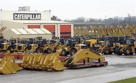 Caterpillar excavator machines are seen at a factory in Gosselies February 28, 2013. REUTERS/Eric Vidal