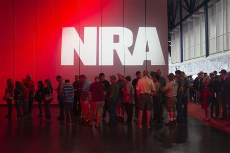Attendees line-up to meet musician Ted Nugent (not pictured) at a book signing event during the National Rifle Association's annual meeting in Houston, Texas on May 5, 2013. Organizers expect some 70,000 attendees at the 142nd NRA Annual Meetings & Exhibits in Houston, which began on Friday and continues through Sunday. REUTERS/Adrees Latif