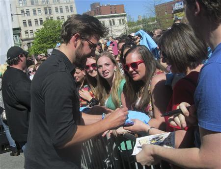 John Krasinski, star of ''The Office,'' meets with fans during the '''The Office' Wrap Party'' in Scranton, Pennsylvania on May 4, 2013. It was part of a daylong celebration the city staged for the show, which included a parade and a cast party. The show, set in Scranton, airs its final episode May 16. Picture taken on May 4, 2013. REUTERS/Michael Sadowski