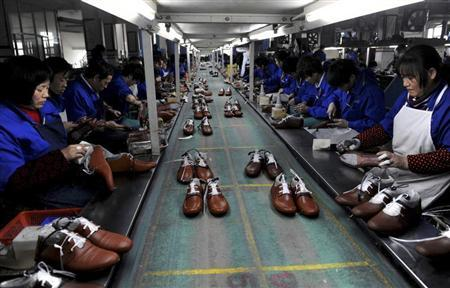 Employees work at a shoe factory in Lishui, Zhejiang province, January 24, 2013. REUTERS/Lang Lang/Files