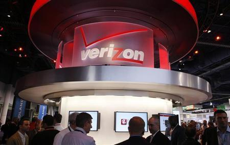Showgowers visit the Verizon booth on the first day of the Consumer Electronics Show (CES) in Las Vegas January 8, 2013. REUTERS/Rick Wilking