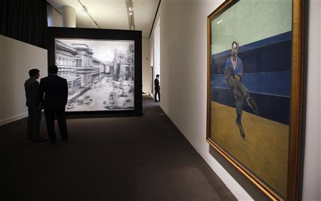 Visitors view Gerhard Richter's 'Domplatz, Mailand (Cathedral Square, Milan)' (L), oil on canvas and executed in 1968, estimated between $30-40 million, and Francis Bacon's 'Study for Portrait of P.L.' dated 1962 and estimated $30-40 million, during a preview of Sotheby's May 14 Contemporary Art Evening Auction at Sotheby's in New York, May 3, 2013. REUTERS/Mike Segar