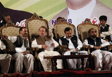 Nawaz Sharif (2nd L), leader of political party Pakistan Muslim League - Nawaz (PML-N), sits on stage with members of his party at an election campaign rally in Islamabad May 5, 2013. REUTERS/Mian Khursheed