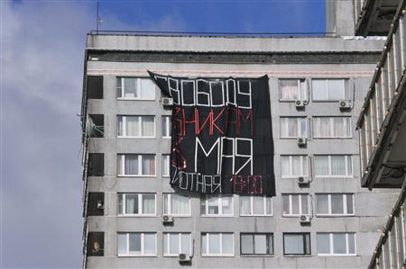 A banner that reads ''Freedom of prisoners on May 6'' is seen in Moscow, May 6, 2013. REUTERS/Anton Stekov