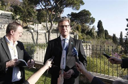Germany's Foreign Minister Guido Westerwelle (C) speaks with the media before a meeting with the Friends of Syria group in Istanbul April 20, 2013. REUTERS/Osman Orsal