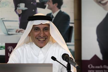 Chief Executive of Qatar Airways Akbar Al Baker laughs during the Arabian Travel Market at Dubai International Convention and Exhibition Centre in Dubai, May 6, 2013. REUTERS/Jumana El Heloueh