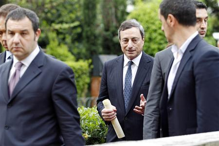 President of the European Central Bank Mario Draghi (C) is escorted by bodyguards as he leaves LUISS University after receiving an honorary degree in political science in Rome May 6, 2013. REUTERS/Giampiero Sposito
