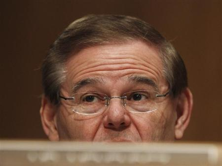 Senator Robert Menendez (D-NJ), a member of the Senate Banking, Housing and Urban Affairs Committee, asks questions during testimony in Washington February 14, 2013. REUTERS/Gary Cameron