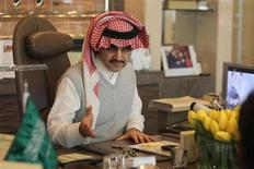 Saudi Prince Alwaleed bin Talal speaks during an interview with Reuters at his office in Kingdom Tower in Riyadh, May 6, 2013. REUTERS/Faisal Al Nasser