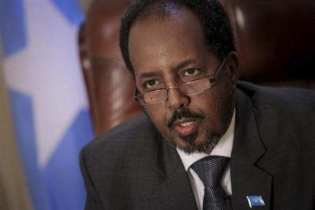 Somali President Hassan Sheikh Mohamud sits in his presidential office at Villa Somalia, the complex which houses the Somali government in the country's capital Mogadishu April 19, 2013, in this picture provided by the African Union-United Nations Information Support Team (AU-UN IST). REUTERS/Stuart Price/AU-UN IST Photo/Handout