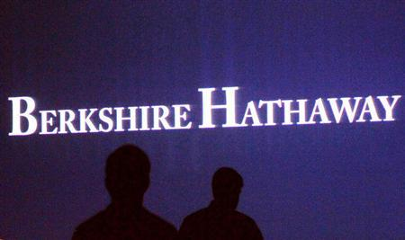 Berkshire Hathaway shareholders walk by a video screen at the company's annual meeting in Omaha May 4, 2013. REUTERS/Rick Wilking