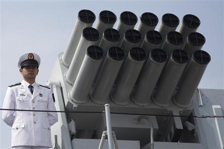 A Chinese People's Liberation Army (PLA) Navy personnel stands on the deck of the Chinese naval guided missile destroyer Haikou (171) during a welcome ceremony as it docks at the Ngong Shuen Chau Naval Base in Hong Kong April 30, 2012. REUTERS/Tyrone Siu