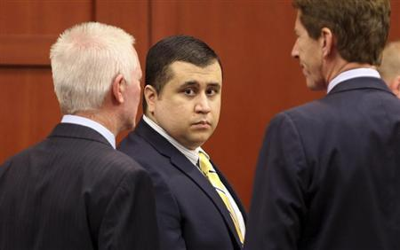 George Zimmerman, defendant in the killing of Trayvon Martin, stands in Seminole circuit court in Sanford, Florida, with his attorney Mark O'Mara (R), for a pre-trial hearing April 30, 2013. REUTERS/Joe Burbank/Pool