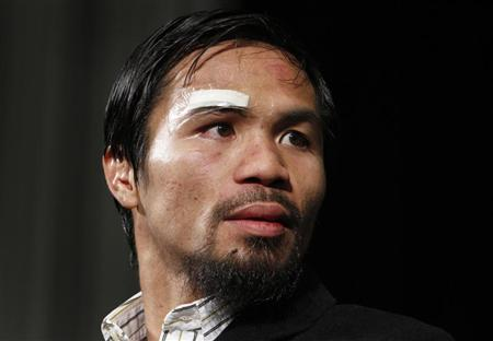 Manny Pacquiao of the Philippines attends a post-fight news conference following his majority decision victory over Juan Manuel Marquez of Mexico at the MGM Grand Garden Arena in Las Vegas, Nevada November 12, 2011. REUTERS/Steve Marcus