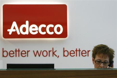 An Adecco employee answers phone calls as she sits at the company's headquarters switchboard in Glattbrugg near Zurich December 15, 2008. REUTERS/Christian Hartmann