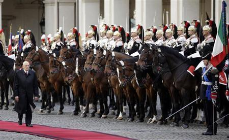 Italy's newly re-elected president Giorgio Napolitano inspects a guard of honor during a welcoming ceremony at the Quirinale palace in Rome, April 22, 2013. REUTERS/Max Rossi
