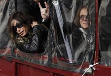 Aerosmith's Steven Tyler (L) and Tom Hamilton lean out the window of a duck boat as they depart for a performance in Boston, Massachusetts November 5, 2012. REUTERS/Jessica Rinaldi