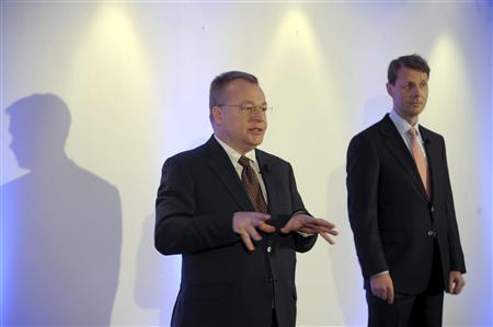 Nokia's Chief Executive Stephen Elop gestures as Nokia Board Chairman Risto Siilasmaa (R) looks on, at a news conference prior to the Annual General Meeting of Nokia Corporation in Helsinki May 7, 2013. REUTERS/Markku Ulander/Lehtikuva