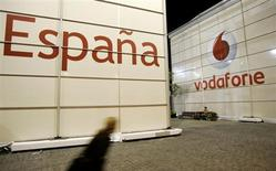 A visitor walks in front of the Vodafone stand during the 3GSM World Congress at the Feria of Barcelona, in central Barcelona February 12, 2007. REUTERS/Gustau Nacarino