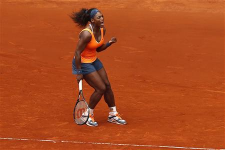 Serena Williams of the U.S. celebrates her victory against Lourdes Dominguez Lino of Spain during their women's singles match at the Madrid Open tennis tournament, May 7, 2013. REUTERS/Juan Medina