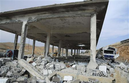 Damage is seen in what appears to be a chicken farm following an air strike near Damascus May 5, 2013, in this handout photograph distributed by Syria's national news agency SANA. REUTERS/SANA/Handout via Reuters