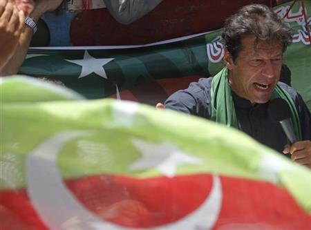 Imran Khan, Pakistani cricketer-turned-politician and chairman of political party Pakistan Tehreek-e-Insaf (PTI), addresses his supporters after his visit to the mausoleum of Mohammad Ali Jinnah, founder and first governor-general of Pakistan, during an election campaign in Karachi May 7, 2013. REUTERS/Athar Hussain