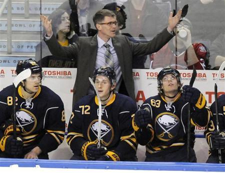 Buffalo Sabres interim head coach Ron Rolston (top) reacts to a penalty during the second period of their NHL hockey game against the Montreal Canadiens in Buffalo, New York April 11, 2013. REUTERS/Doug Benz