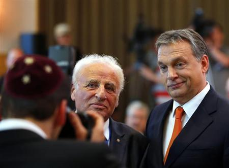 Hungarian Prime Minister Viktor Orban poses with Gusztav Zoltai (L), managing director of the Federation of Jewish Communities in Hungary during the 14th Plenary Assembly of the World Jewish Congress in Budapest May 5, 2013. REUTERS/Laszlo Balogh