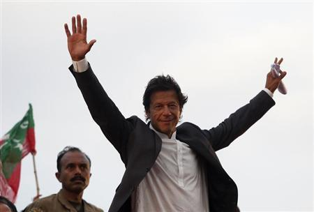 Imran Khan, Pakistani cricketer-turned-politician, Chairman of political party Pakistan Tehreek-e- Insaf (PTI) waves to his supporters during a rally in Lahore March 23, 2013. REUTERS/Mohsin Raza