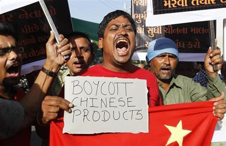 Traders shout slogans during a protest against China in the western Indian city of Ahmedabad May 3, 2013. REUTERS/Amit Dave