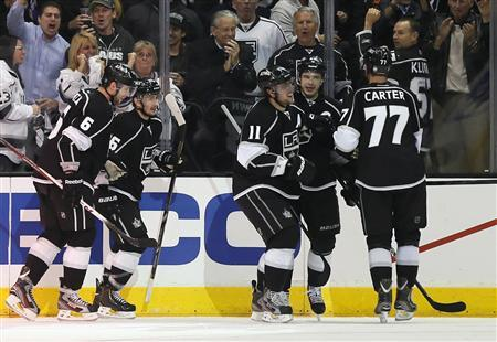 Los Angeles Kings Anze Kopitar (3rd R) celebrates with Dustin Brown (2nd R) and Jeff Carter after scoring against the St. Louis Blues during the third period of Game 4 of their NHL Western Conference quarterfinals hockey playoffs in Los Angeles May 6, 2013. REUTERS/Lucy Nicholson