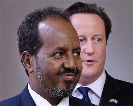 Somalia's President Hassan Sheikh Mohamud (L) and Britain's Prime Minister David Cameron arrive for a Somalia Conference media briefing at the Foreign and Commonwealth Office in central London May 7, 2013. REUTERS/Ben Stansall/POOL