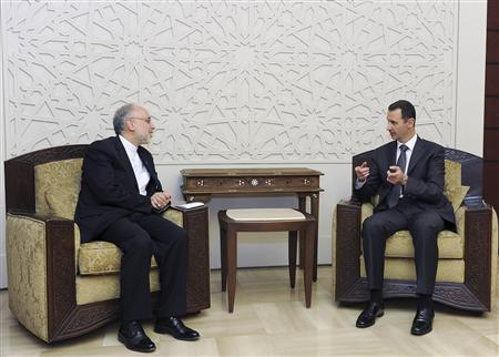 Syria's President Bashar al-Assad (R) meets Iran's Foreign Minister Ali Akbar Salehi, in Damascus May 7, 2013, in this handout photograph released by Syria's national news agency SANA. SANA/Handout via Reuters