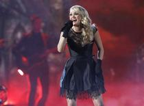 "Carrie Underwood performs ""Two Black Cadillacs"" at the 48th ACM Awards in Las Vegas, April 7, 2013. REUTERS/Mario Anzuoni"