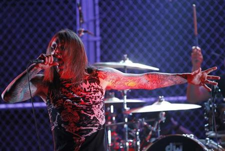 Singer Tim Lambesis of As I Lay Dying performs at the 2nd annual Golden Gods awards in Los Angeles April 8, 2010. REUTERS/Mario Anzuoni