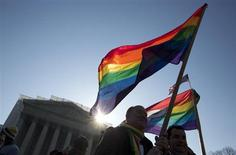 Supporters of gay marriage hold rainbow-colored flags as they rally in front of the Supreme Court in Washington March 27, 2013. REUTERS/Joshua Roberts