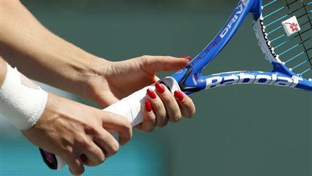 Agnieszka Radwanska of Poland grips her racquet as she receives serve from Elena Dementieva of Russia during their match at the Indian Wells WTA tennis tournament in Indian Wells, California March 17, 2010. REUTERS/Kevin Lamarque