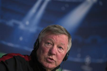 Manchester United's manager Alex Ferguson speaks during a news conference at Santiago Bernabeu Stadium in Madrid in this February 12, 2013 file photo. REUTERS/Juan Medina/Files