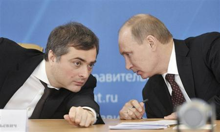 Russian Prime Minister Vladimir Putin (R) talks with Deputy Prime Minister Vladislav Surkov as they attend a meeting on the modernization of regional systems of higher education in the Russian Siberian city of Kurgan February 13, 2012. REUTERS/Alexei Nikolsky/RIA Novosti/Pool
