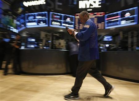 A trader works on the floor at the New York Stock Exchange, April 16, 2013. REUTERS/Brendan McDermid