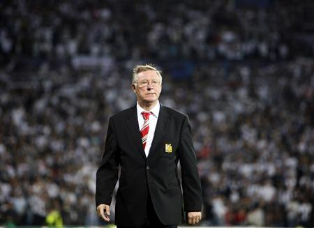Manchester United's manager Alex Ferguson walks before their Champions League soccer match aganist Besiktas at the Inonu Stadium in Istanbul in this September 15, 2009 file photograph. REUTERS/Osman Orsal/Files