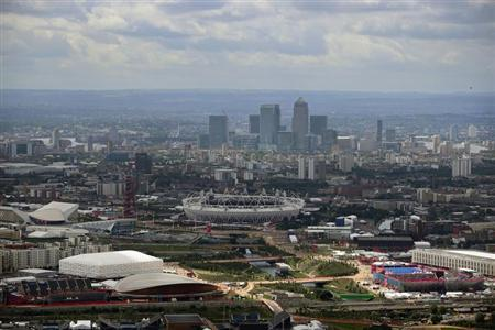 The financial district of Canary Wharf is seen in the background in this aerial view of the Olympic Stadium at the London 2012 Olympic Games, east London August 3, 2012. REUTERS/Jeff J Mitchell/Pool