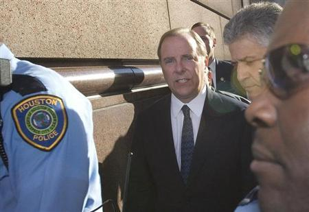 Former Enron Corp. chief executive Jeff Skilling (C) walks with attorney Daniel Petrocelli (R) as he is escorted from Federal court in Houston, after he was sentenced to more than 24 years in prison for his part in the financial scandal that brought down the company and came to symbolize a dark era in U.S. business, October 23, 2006 file photo. REUTERS/Richard Carson