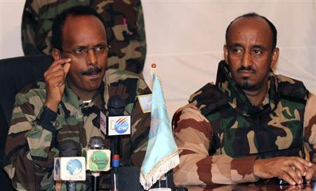 Somalia's Prime Minister Mohamed Abdullahi Mohamed (L) and Defence Minister Abdihakim Haji Fiqi give a news conference in the capital Mogadishu February 23, 2011. REUTERS/Omar Faruk