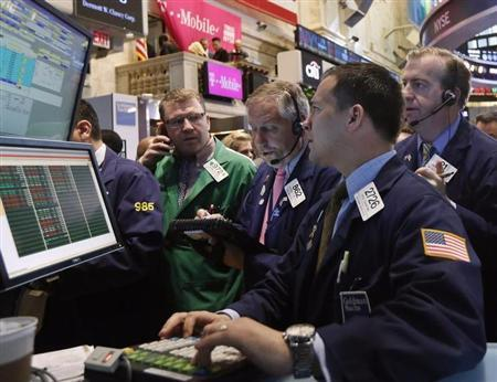 Traders work on the floor at the New York Stock Exchange, May 1, 2013. REUTERS/Brendan McDermid