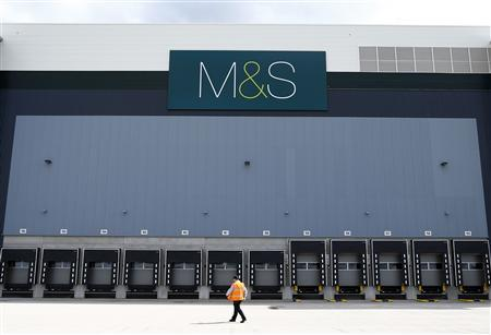 A worker walks past the dispatch area at the new Marks & Spencer e-commerce distribution centre in Castle Donington, central England May 8, 2013. REUTERS/Darren Staples