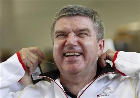 German Olympic Sports Confederation (Deutscher Olympischer Sportbund, DOSB) President Thomas Bach laughs during the kitting out session for the German team participating in the 2012 London Olympic Games, in Mainz June 28, 2012. REUTERS/Ralph Orlowski