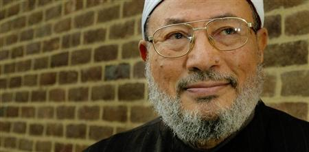Professor Shaikh Youssef al-Qaradawi poses for photographs in London January 21, 2003. REUTERS/Toby Melville