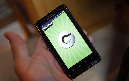 The Groupon smartphone app is displayed on a Motorola Droid Bionic cell phone in Denver November 4, 2011. REUTERS/Rick Wilking/Files